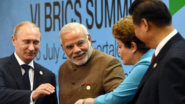 Prime Minister Narendra Modi (centre) poses with Russian President Vladimir Putin (extreme left), Chinese premier Xi Jinping (extreme right) and former Brazilian President Dilma Rousseff at the VI BRICS Summit in July 2014.(AFP)