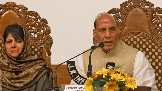 Union home minister Rajnath Singh speaks next to Jammu and Kashmir chief minister Mehbooba Mufti during press conference at Sher-i-Kashmir International Conference Centre, in Srinagar, on Thursday.(Waseem Andrabi/HT Photo)