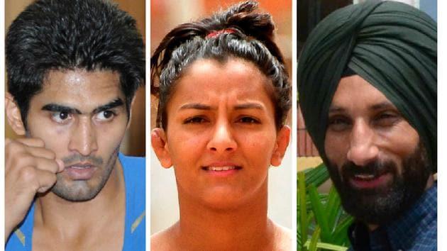(Left to right) Vijender Singh, Geeta Phogat and Sardara Singh.(HT Photo)