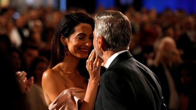 Actor George Clooney kisses his wife and human right lawyer Amal Clooney at the 46th AFI Life Achievement Award Gala in Los Angeles.(REUTERS)