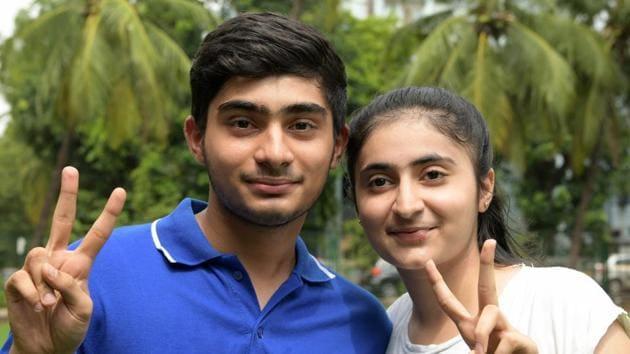 Twins Smit Dama 87% and Siddhi Dama 95.40% celebrate their success in SSC board exam from Fr. Agnels School Vashi in Navi Mumbai on Friday.(Bachchan Kumar/ Hindustan Times)