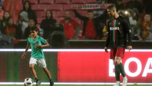 Cristiano Ronaldo's son Cristianinho received some of the biggest cheers of the night from theEstadio da Luz crowd(REUTERS)