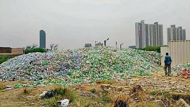 Officials said the stack of plastic waste on the 1,000 square yard plot is around seven feet high, taller than the boundary wall.(HT Photo/Pankaj Gupta)