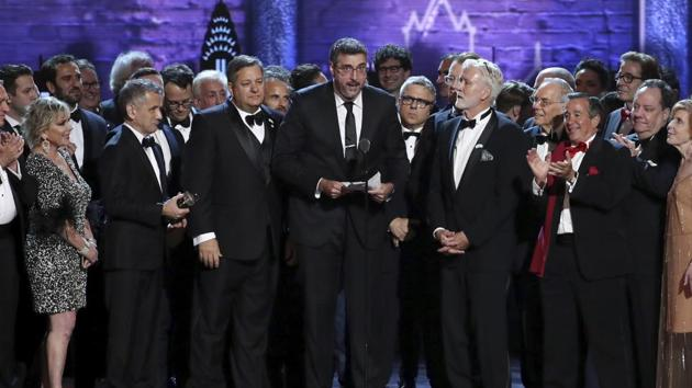 Orin Wolf, center, and the cast and crew of 'The Band's Visit' accept the award for best musical at the 72nd annual Tony Awards at Radio City Music Hall.(Invision)