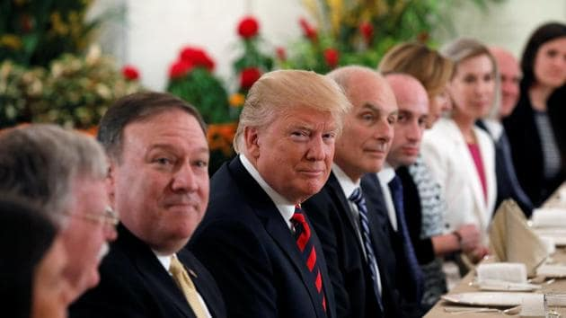 U.S. President Donald Trump flanked by Secretary of State Mike Pompeo and White House Chief of Staff John Kelly attend a lunch with Singapore's Prime Minister Lee Hsien Loong and officials at the Istana in Singapore June 11, 2018.(REUTERS)