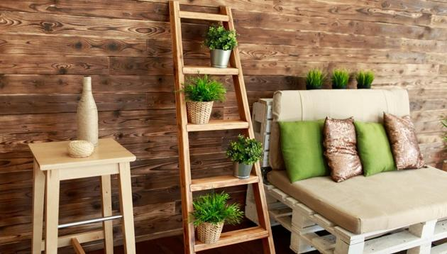 An increasing number of interior designers are suggesting going for wooden decor to give your home a pleasant look, be it wall shelves or curtain rods.(Shutterstock)