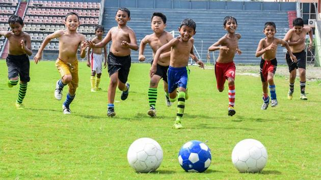 Young footballers in Guwahati practice the sport at a coaching centre as FIFA fever grips various parts of the country, June 6, 2018(PTI)