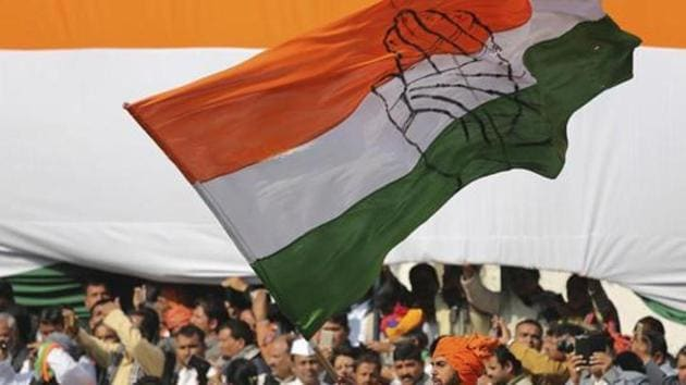 A Congress party worker waves the party flag during a function.(AP Representative Photo)