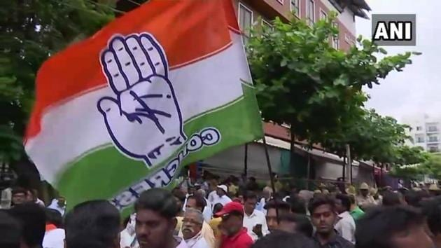 Congress workers celebrate outside counting centre in Bengaluru after party wins Jayanagar assembly seat.(ANI Photo)