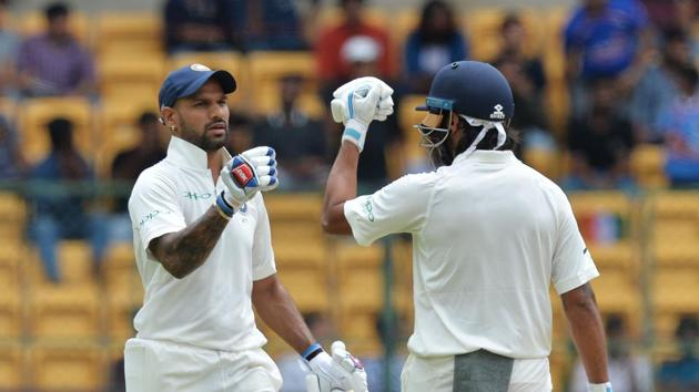 Shikhar Dhawan's century and Murali Vijay's magnificent knock put India on top in the one-off Test against debutant Afghanistan at the M Chinnaswamy Stadium in Bangalore on Thursday.(AFP)