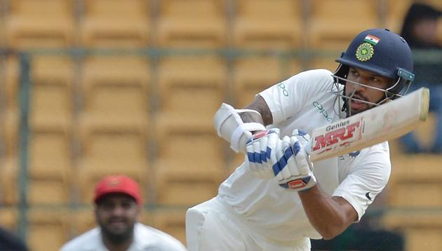Shikhar Dhawan in action during day one of the Test match between India and Afghanistan at the M. Chinnaswamy Stadium in Bangalore. Get full cricket score of India vs Afghanistan, one-off Test, Day 1, Bangalore, here(AFP)