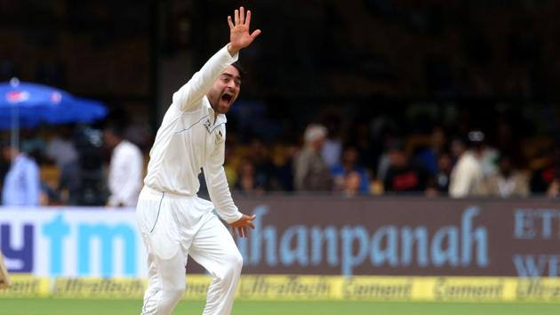 Rashid Khan got his first Test wicket when he dismissed Ajinkya Rahane during the one-off Test against Afghanistan. Get highlights of India vs Afghanistan , one-off Test, Bangalore here.(BCCI)