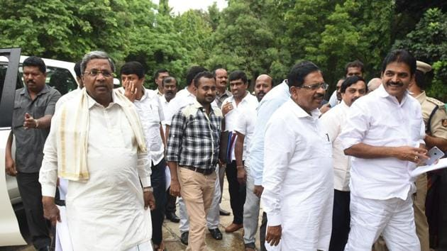 Former Karnataka CM Siddaramaiah (left) arrives for the first co-ordination committee meeting in Bengaluru on Thursday.(Arijit Sen/HT Photo)