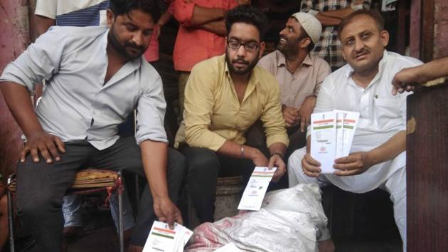 The Aadhar cards found at a scrap dealer's shop in Jaipur.(HT Photo)