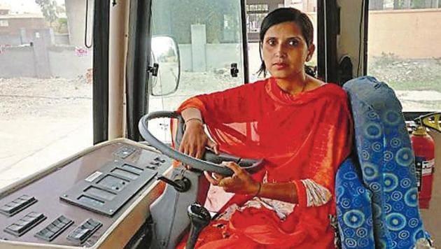 Archana on the wheel of a Karnal city bus.(HT Photo)