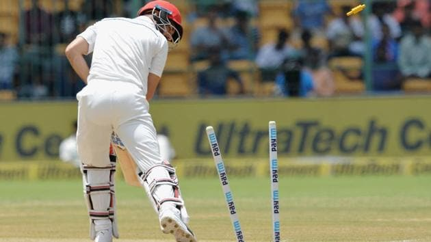 Afghanistan were defeated by an innings and 262 runs by India in their inaugural Test match in Bangalore on Friday.(AFP)