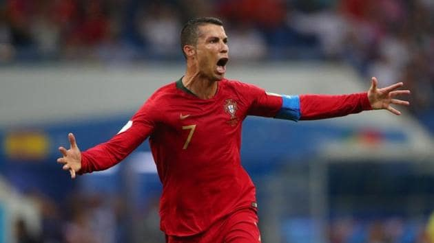 Cristiano Ronaldo scored a hat-trick in Portugal's first game as he led from the front in ensuring a 3-3 draw against 2010 World Cup winners Spain.(REUTERS)