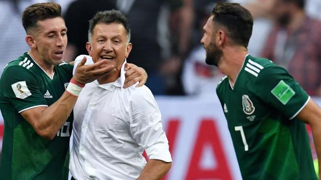Mexico's coach Juan Carlos Osorio (C) celebrates his team's win with Mexico's midfielder Hector Herrera (L) and Mexico's defender Miguel Layun during the Russia 2018 World Cup Group F football match against Germany.(AFP)
