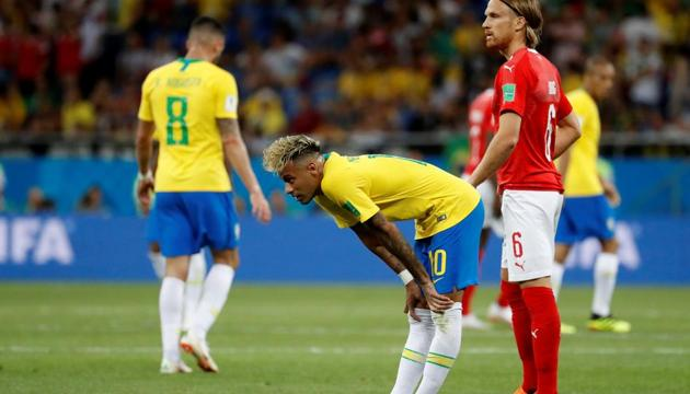 <p>Brazil's Neymar looks dejected as Switzerland's Michael Lang looks on at the end of the Group E match at the FIFA&thinsp;World Cup 2018.</p> (REUTERS)