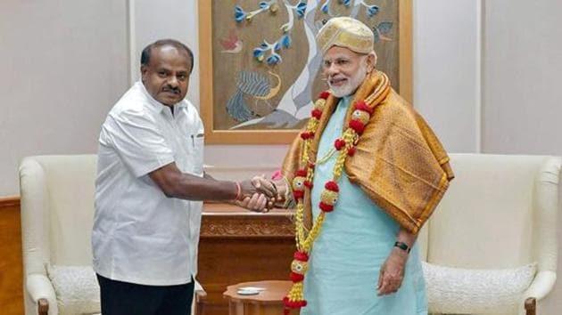 Karnataka chief minister HD Kumaraswamy meets Prime Minister Narendra Modi, in New Delhi, May 28(PTI)
