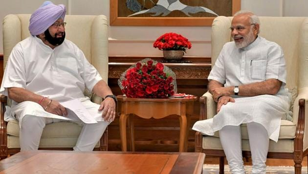 Prime Minister Narendra Modi with Punjab chief minister Amarinder Singh in New Delhi on Monday.(PTI Photo)