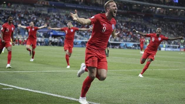 <p>England's Harry Kane (C) celebrates after scoring during the group G match between Tunisia and England at the 2018 FIFA World Cup in the Volgograd Arena in...