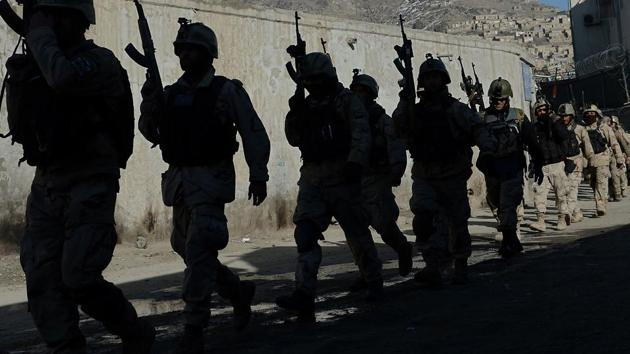 In this file photo taken on January 21, 2013 Afghan commandos walk down a road near the Kabul police headquarters building after a clash between Afghanistan forces and Taliban fighters in Kabul.(AFP File Photo)