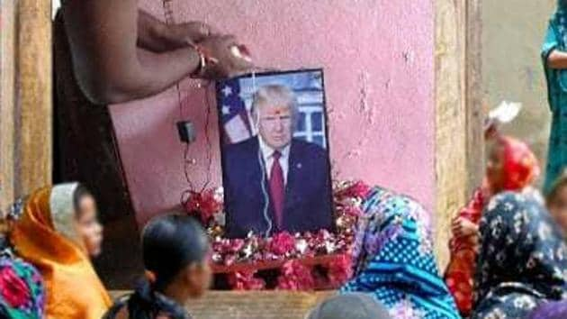 Bussa Krishna performs puja for a photo of US president Donald Trump at his home.(HT Photo)