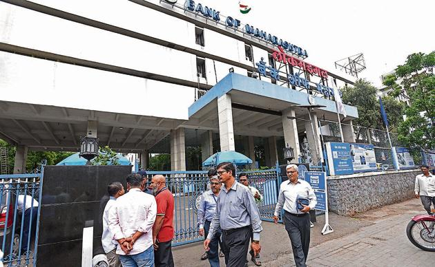 Shareholders coming out of the Bank of Maharashtra head office in Shivajinagar after the annual general meeting on Thursday.(Pratham Gokhale/HT Photo)