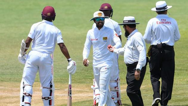 Sri Lanka captain Dinesh Chandimal (C) has been suspended for the third and final Test against West Indies after being found guilty of changing the condition of the ball in the second Test.(AFP)