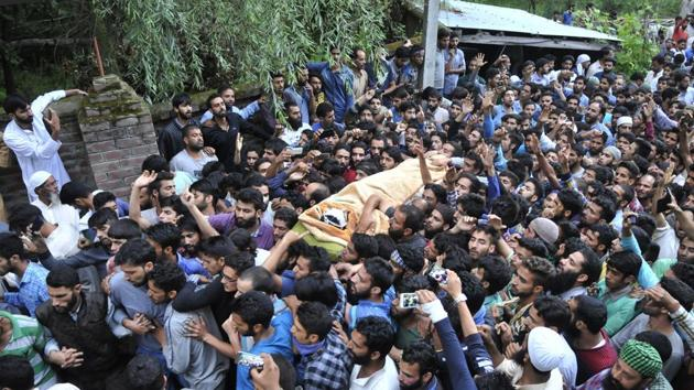 Kashmiris carry the body of Hizbul Mujahideen commander Burhan Wani during his funeral procession in Tral on July 9, 2016. The killing of Wani, considered a hero among locals, sparked months of unrest in the Valley, pitting civilians against security forces and leading to scores of deaths and dozens more injured.(Waseem Andrabi/ HT File Photo)