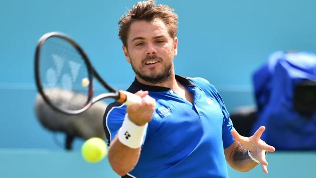 Stan Wawrinka returns to Sam Querrey during their match at the Queen's Club tennis tournament on Wednesday.(AFP)