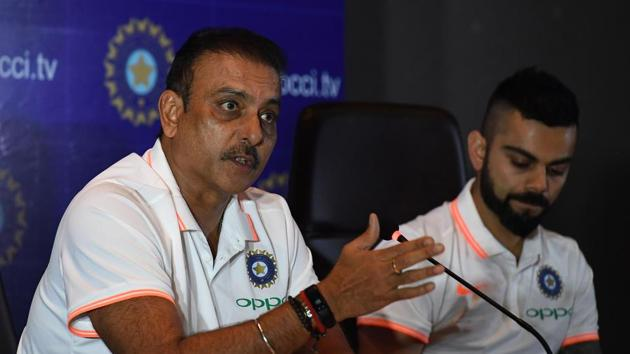 Indian cricket team head coach Ravi Shastri (L) speaks as captain Virat Kohli looks on during a press conference in New Delhi.(AFP)