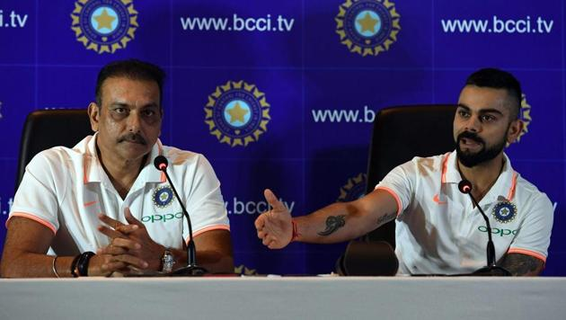 Indian cricket team head coach Ravi Shastri (L) watches as captain Virat Kohli speaks during a press conference in New Delhi on June 22, 2018.(AFP)