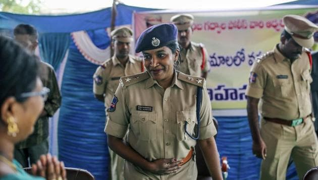 <p>Rema Rajeshwari, superintendent of police for the Indian Police Service, attends an event to raise awareness on fake news in Balgera village, Telangana. At a...