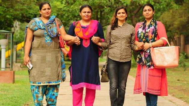 Deserted by their NRI husbands (from left) Reena Chauhan, Amrit Pal Kaur, Ritu Sharma and Rupali Gupta are putting up a joint fight under the banner of Together We Can, in Chandigarh. Their initiative led to the Regional Passport Office to suspend the passport of the runaway grooms.(Ravi Kumar/HT)