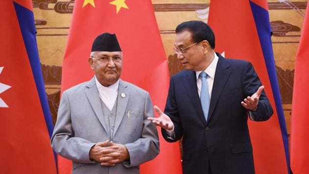 Nepal's Prime Minister KP Sharma Oli (L) chats with Chinese Premier Li Keqiang during a signing ceremony at the Great Hall of the People in Beijing on June 21.(AFP Photo)
