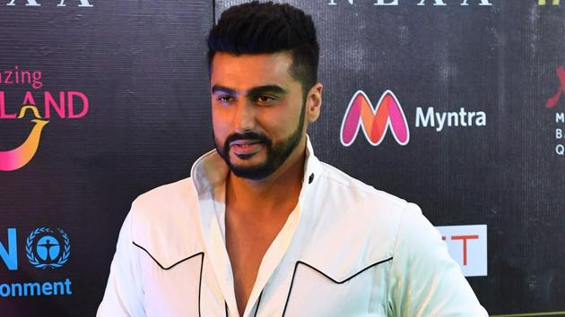Bollywood actor Arjun Kapoor poses for a picture as he arrives for the IIFA Rocks of the 19th International Indian Film Academy (IIFA) festival.(AFP)