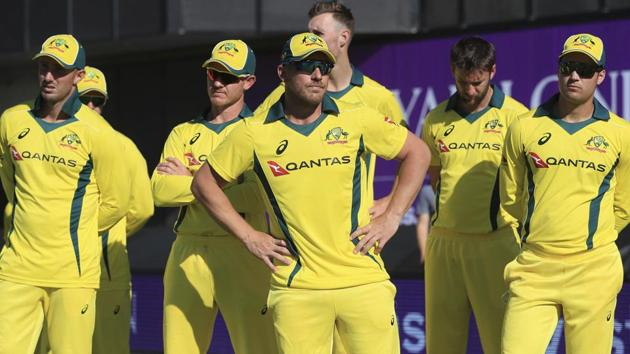 Australia players stand dejected after losing their One Day International cricket match against England at Emirates Old Trafford.(AP)