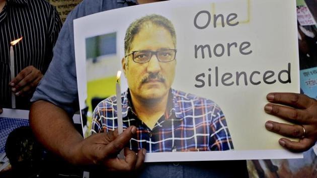 A journalist participates in a silent protest against the brutal killing of a senior Kashmiri journalist Shujaat Bukhari, in Kolkata.(AP Photo)