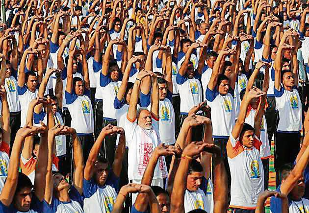 Prime Minister Narendra Modi performed yoga along with 50,000 others in Dehradun. Rawat said the hill state holds huge possibilities in the yoga and Ayurveda sectors.(AP File)