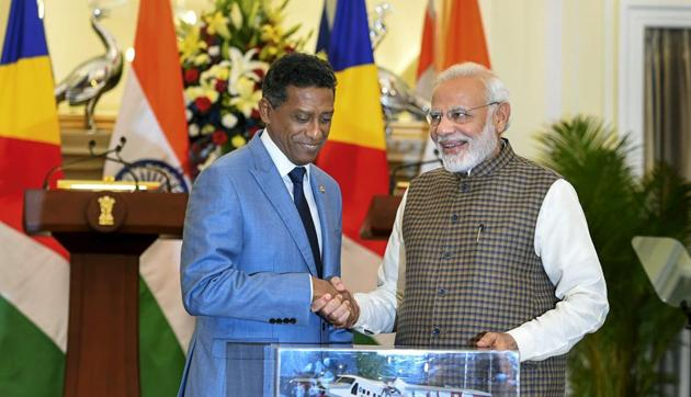 Prime Minister Narendra Modi pose for a photo with model of Dornier aircraft which will be gifted to Seychelles President Danny Antoine Rollen Faure after their meeting at Hyderabad House, in New Delhi on Monday, June 25, 2018.(PTI Photo)