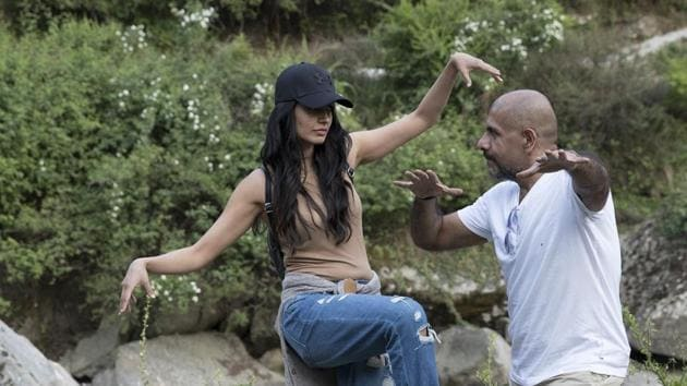 Sarah and Vishal Dadlani trying to summon a genie that would help them setup a tent and some food that they can grill.