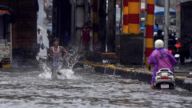 <p>Rain continued to batter Mumbai, killing four people in 24 hours in the city and Thane district. Several areas witnessed traffic snarls and waterlogging...