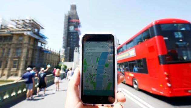 A photo illustration shows the Uber app and a bus in London, Britain on June 25.(Reuters)