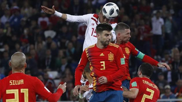 Morocco's Youssef En Nesyri, top, scores his side's second goal during the Group B match vs Spain at the 2018 FIFA World Cup at the Kaliningrad Stadium on Monday.(AP)