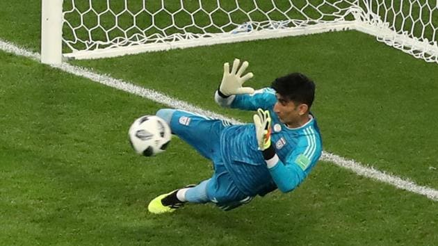 Alireza Beiranvand (in pic) saves a penalty taken by Cristiano Ronaldo during the FIFA World Cup 2018 match between Portugal and Iran in Saransk on Monday.(REUTERS)