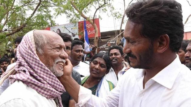 YSR Congress chief YS Jaganmohan Reddy meets people during his padyatra. He has completed 200 days of his marathon foot march intended as political outreach ahead of the elections in Andhra Pradesh.(HT Photo)