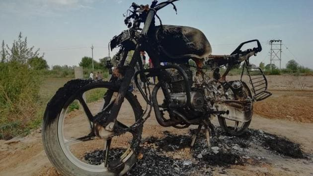 A motorcycle that was set ablaze during a clash between two villages at Hansi in Hisar district on Monday.(HT Photo)