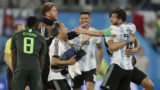 Argentina's Lionel Messi, right, celebrates after the group D match against Nigeria at the FIFA World Cup 2018 in the St. Petersburg.(AP)
